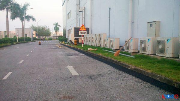 Bề mặt hoàn thiện quá trình thảm bê tông nhựa nóng tại nhà máy Molex